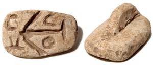 An example of a Roman bread stamp and loaf with the stamps insignia