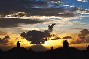 Sun rises over suburbia